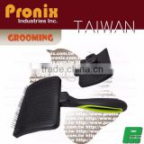 Ergonomic self-cleaning slicker brush