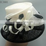 white and black church hat with pearl decoration