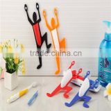 Plastic wall superman suction cup toothbrush holder