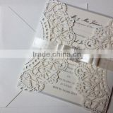 laser cut wedding invitation cards in white and ivory along with printed inserts for wedding stationers, wedding invitation desi