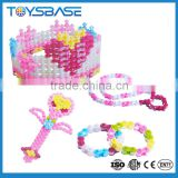 Girls playing creative DIY jewelry set plastic blocks building toy