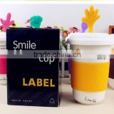 creative big capacity heat insulated thumb smile face expression ceramic mug with silicon rubber and cover