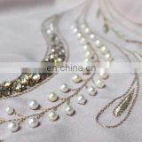 Pearl and crystal embroidered fabric