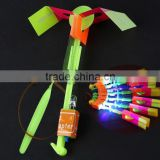 Hot sellingElastic Toy Gift Flash Rotating Flying Arrow Rocket Helicopter/kids light up led rubbe band flashing led flying arrow