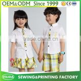Hot selling kindergarten uniform new fashion primary school uniform white shirt and yellow checked shorts or skirt