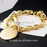 Wholesale stainless steel gold charm bracelet round disk Bracelet with T clasp 9311