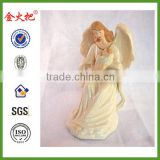 Polyresin angel with baby Jesus figurine