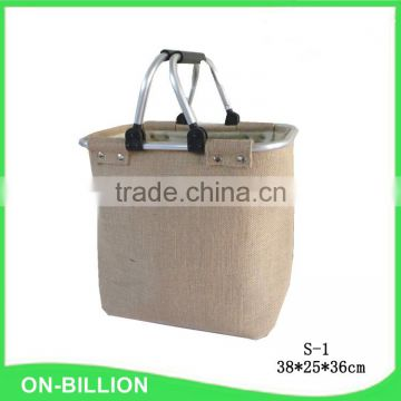 Collapsible jute fabric laundry basket with removable handles