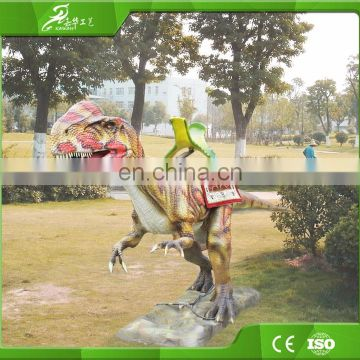 Theme park amusement kiddie rides on dinosaur