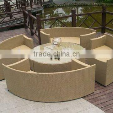 circle rattan glass top tables and sofas
