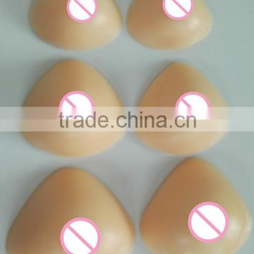 triangle shape hot selling fake sexy silicone breast falsies for male cross dressing or female breast enhancements or prosthesis