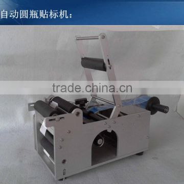 Semi-automatic round bottle labeling machine with code printer
