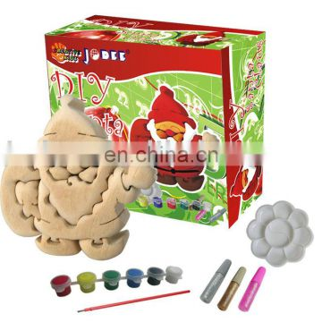 DIY Painting wooden toy for christmas santa claus with color paint