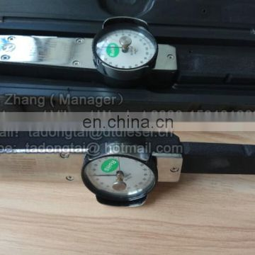 Torque wrench with torque gauge