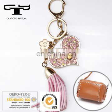 fancy gold metal heart shaped with PU tassels pendant Bag & garment accessories