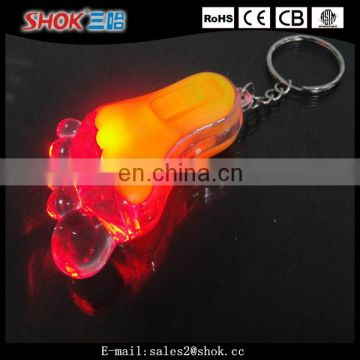 Souvenir cute foot flashing led keychain