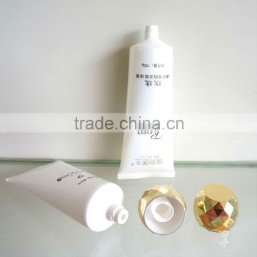 plastic oval tube with plating gold screw on cap for face washing Dia 40mm