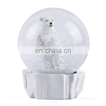 white resin bear snow globe