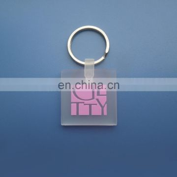 custom embossed brand logo square shape transparent clear soft rubber pvc keychain decoration key holder