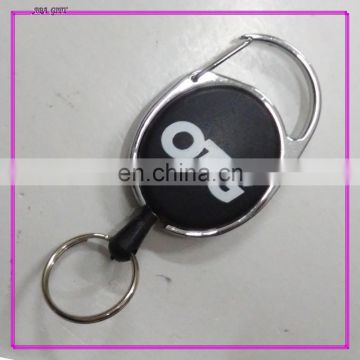 rotating carabiner retractor for name badge holder