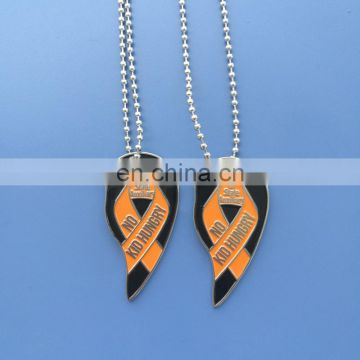 NO KID HUNGRY metal enamel ribbon necklace - charity