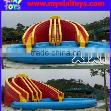 XIXI giant dual lane inflatable water slide with large swimming pool                                                                                                         Supplier's Choice