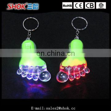 Promotion item foot shaped flashing led keychain for girls