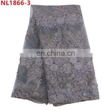 Wholesale african french lace fabric embroidery beaded net lace fabric for wedding .