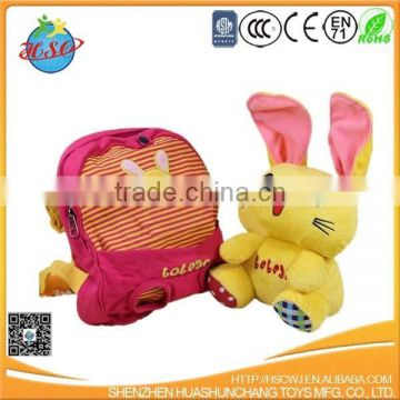 plush rabbit toy with child school backpack bag