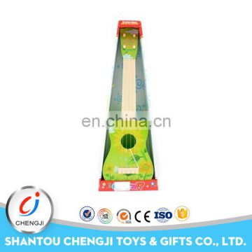 Low price musical instrument plastic toy mini guitar for kids