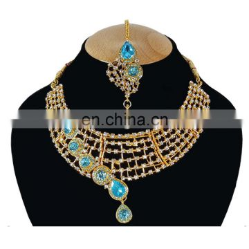 One Sided designer Turquoise Color Stone Gold Plated Kundan Zerconic Necklace Earrings Tikka