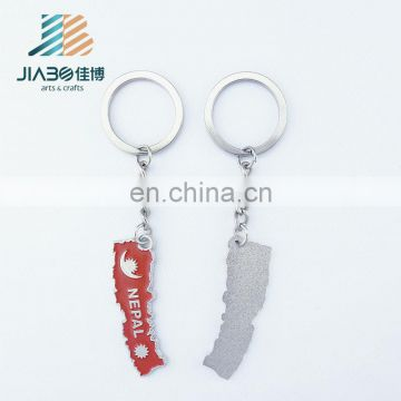 Nepal soft enamel irregular shaped souvenir custom metal keychain supplier
