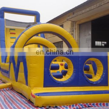 giant blue/yellow inflatable obstacle course