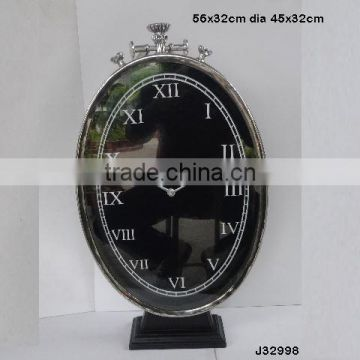 vertical oval shape steel Metal table clock on base in mirror polish other finishes available
