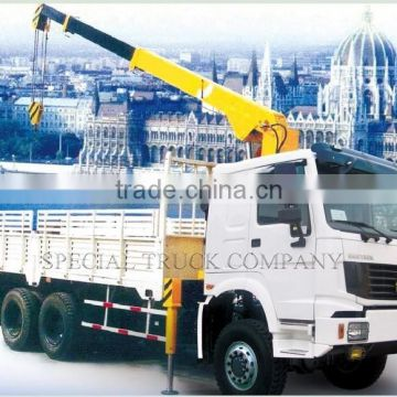 HOWO Mounted crane loading 30TCargo truck with crane