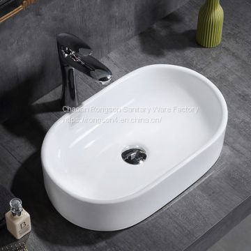 Chaozhou good design ceramic white deep washing dinner oval basin sink with no hole for sale