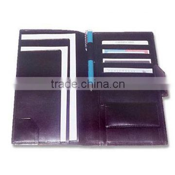 Promotional travel wallet with snap closure