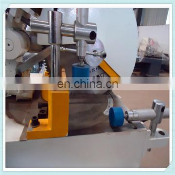 Double-head mitre saw for PVC window processing