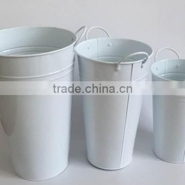 white metal decorative planters