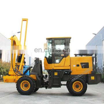 Highway use loader guardrail pile driver with two power head for piling and drilling