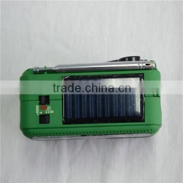 Design solar emergency radio, hand crank to wind up, flashlight, phone charger, green