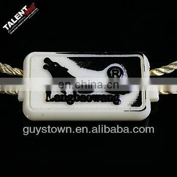 custom emboss brand name logo plastic string lock tag for hangtag