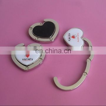 custom design hearted shape bag hangers purse hangers for banquet