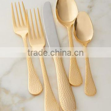 golden hammered antique cutlery