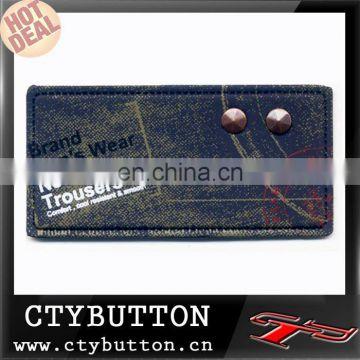 pu label with jeans cotton outside two rivets pu leather label factory