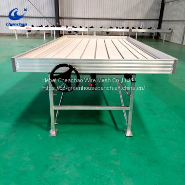 Growing greenhouse plants metal rolling bench ebb and flow system