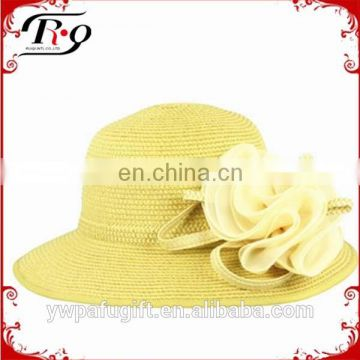 faddish women's straw hat with removable floral ornament
