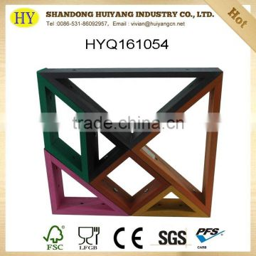 tangram shape wooden display rack against wall