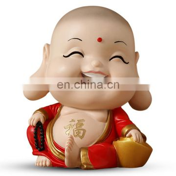 laughing and sitting little monk religious figure for gifts and decoration
