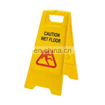 yellow warning sign used in wet floor